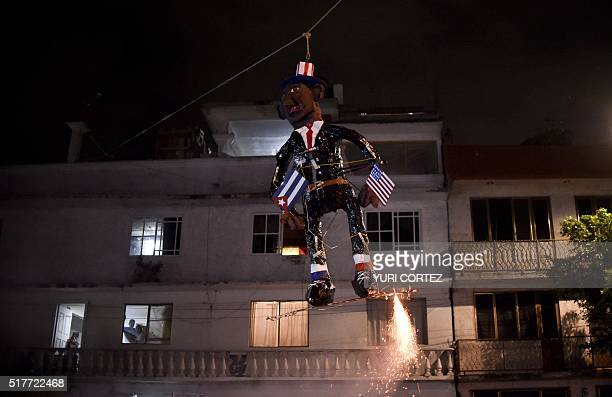 Mexican's set fire to an effigy depicting US President Barack Obama during Holy Week celebrations in Mexico City on March 26 2016 For many years...