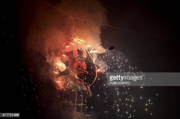 Mexican's set fire to an effigy during Holy Week celebrations in Mexico City on March 26 2016 For many years Mexicans have made cardboard figures...