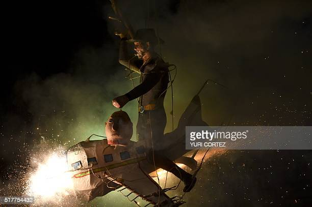 Mexican's set fire to an effigy with the head of US Republican presidential candidate Donald Trump on March 26 2016 in Mexico City during Holy Week...