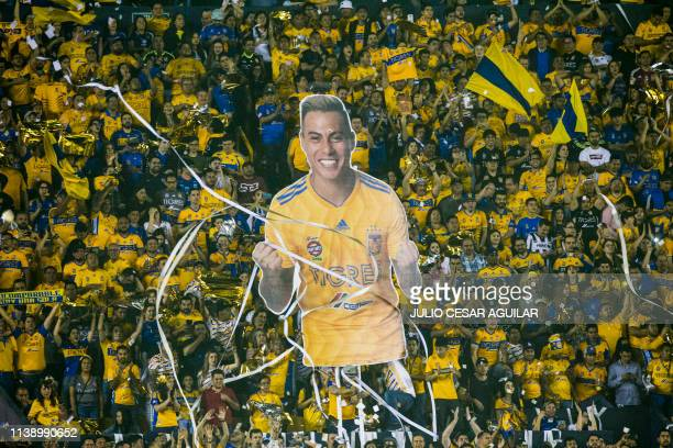 TOPSHOT Mexicans Tigres supporters cheer for their team during the CONCACAF Champions League first leg football final at the Universitario stadium in...