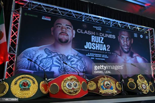 MexicanUS heavyweight boxing champion Andy Ruiz Jr's four belts WBA IBF WBO and IBO are laid out ahead of a promotional press conference for the...