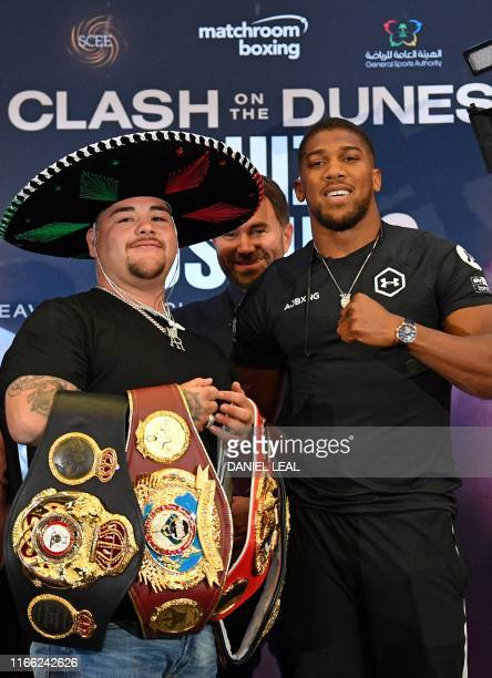 MexicanUS WBA IBF WBO and IBO heavyweight boxing champion Andy Ruiz Jr and Britain's Anthony Joshua pose next to each other at a promotional press...