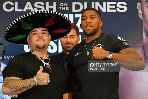 Mexican-US WBA, IBF, WBO and IBO heavyweight boxing champion Andy Ruiz Jr and Britain's Anthony Joshua pose next to each other at a promotional press...