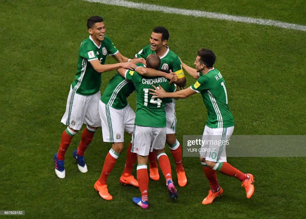 Mexicn players celebrate a goal of their team during their 2018 FIFA World Cup qualifier football match against Costa Rica in Mexico City on March 24, 2017. /