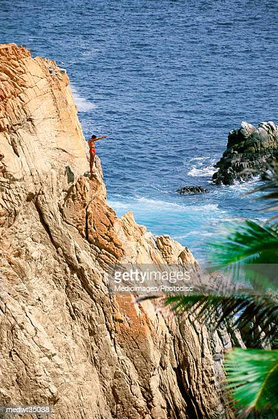 Mexico, Acapulco, Cliff diver climbing on rock face