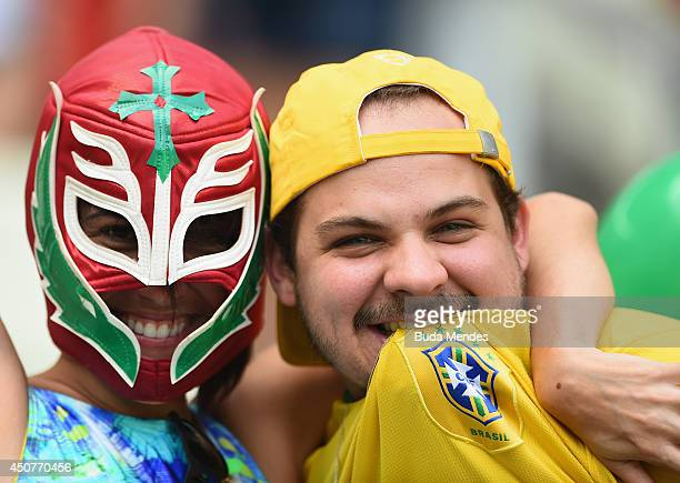 Mexico and Brazil fans pose together before the 2014 FIFA World Cup Brazil Group A match between Brazil and Mexico at Castelao on June 17 2014 in...