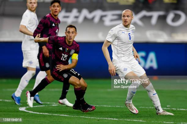 Mexico Andres Guardado and Iceland Aaron Elis Thrandarson look for the ball during the game between Mexico and Iceland on May 29, 2021 at AT&T...