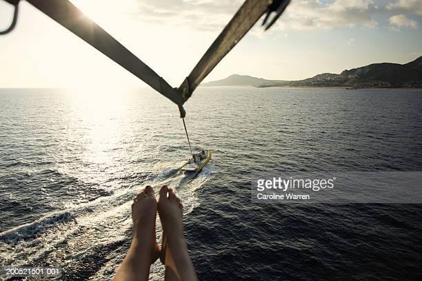 'Mexico, Baja, Cabo San Lucas, mature woman parasailing, low section'