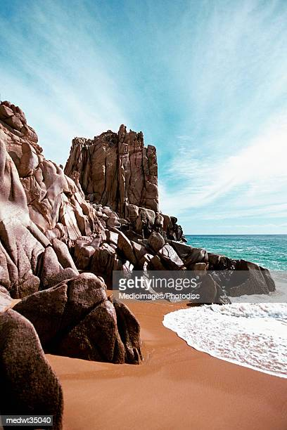 mexico, baja california, cabo san lucas, waves crashing on solmar beach - cabo san lucas stock pictures, royalty-free photos & images