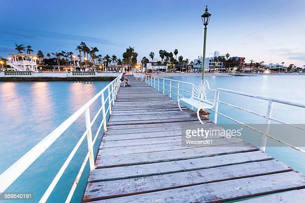 Mexico, Baja California Sur, La Paz, wooden boardwalk at blue hour