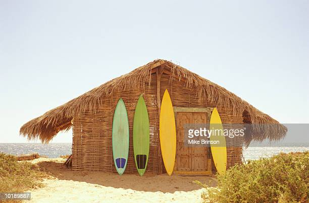 Mexico, Baja California, surfboards leaning against beach shack