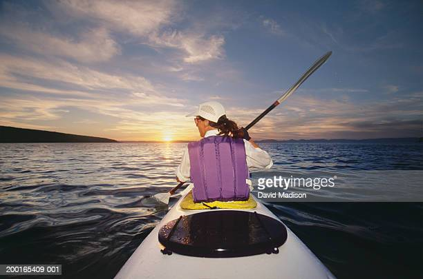 mexico, baja, sea of cortez, mature woman kayaking, sunrise, rear view - sea of cortez stock pictures, royalty-free photos & images