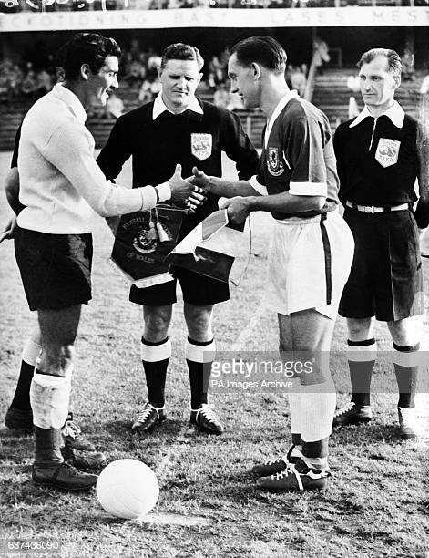 Mexico captain Antonio Carbajal shakes hands with Wales captain Dave Bowen watched by referee Leo Lemesic