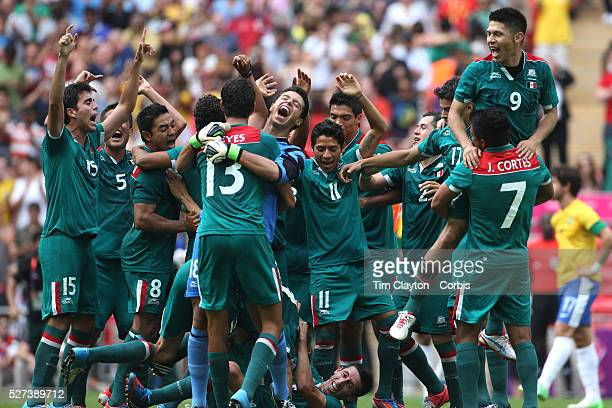Mexico celebrate their Gold Medal win after defeating Brazil 21 during the Brazil V Mexico Gold Medal Men's Football match at Wembley Stadium during...