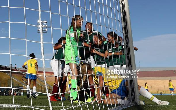 Mexico celebrates a goal by Vanessa Buso in front of Mayara Nabosne Harendt of Brazil during the FIFA U17 Women's World Cup Uruguay 2018 group B...