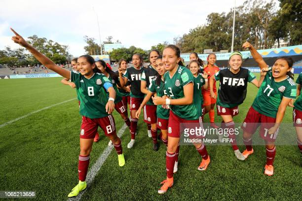 Mexico celebrates after defeating Ghana in the FIFA U17 Women's World Cup Uruguay 2018 quarter final match at Estadio Charrua on November 25 2018 in...