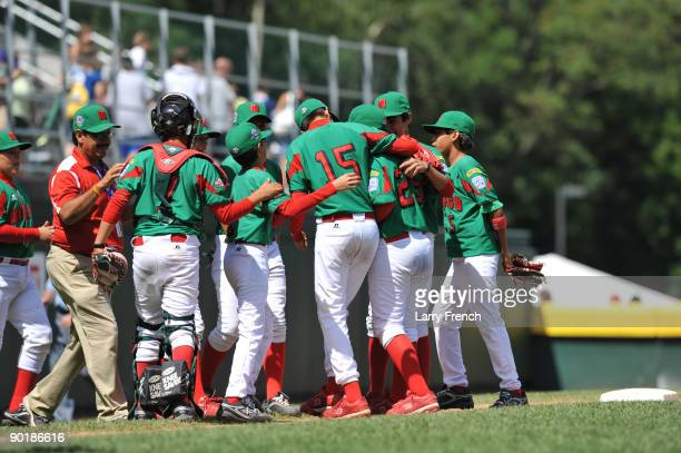 Mexico celebrates their win against Texas in the consolation game at Volunteer Stadium on August 30 2009 in Williamsport Pennsylvania Mexico defeated...