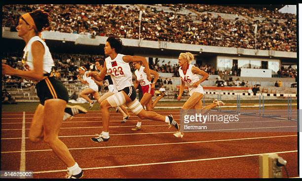 Maureen Caird of Australia crosses the finish line to win the gold medal in the Women's 80meter hurdles in the 1968 Olympics In the next lane is the...
