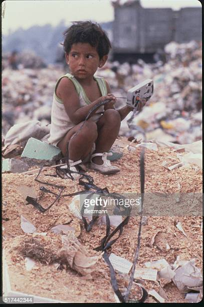 A child of the Sindicato de los Pepenedores or Scavengers Union sits on a trash heap at the Santa Catarina Dump outside Mexico City Mexico City's...