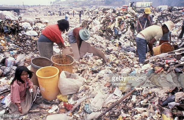 A family of the Sindicato de los Pepenedores or Scavenger's Union sort through trash at the Santa Catarina Dump outside of Mexico City Mexico City's...