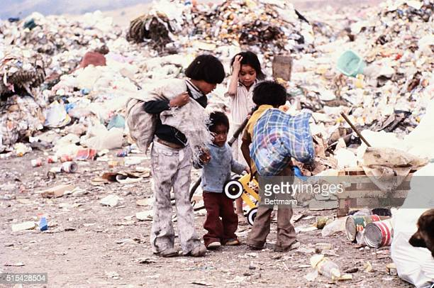 A group of children from the Sindicato de los Pepenedores or Scavengers Union walk by piles of trash at the Santa Catarina Dump outside of Mexico...