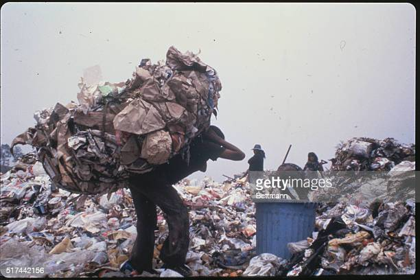 A member of the Sindicato de los Pepenedores or Scavengers Union carries a pile of trash on his back at the Santa Catarina Dump outside Mexico City...