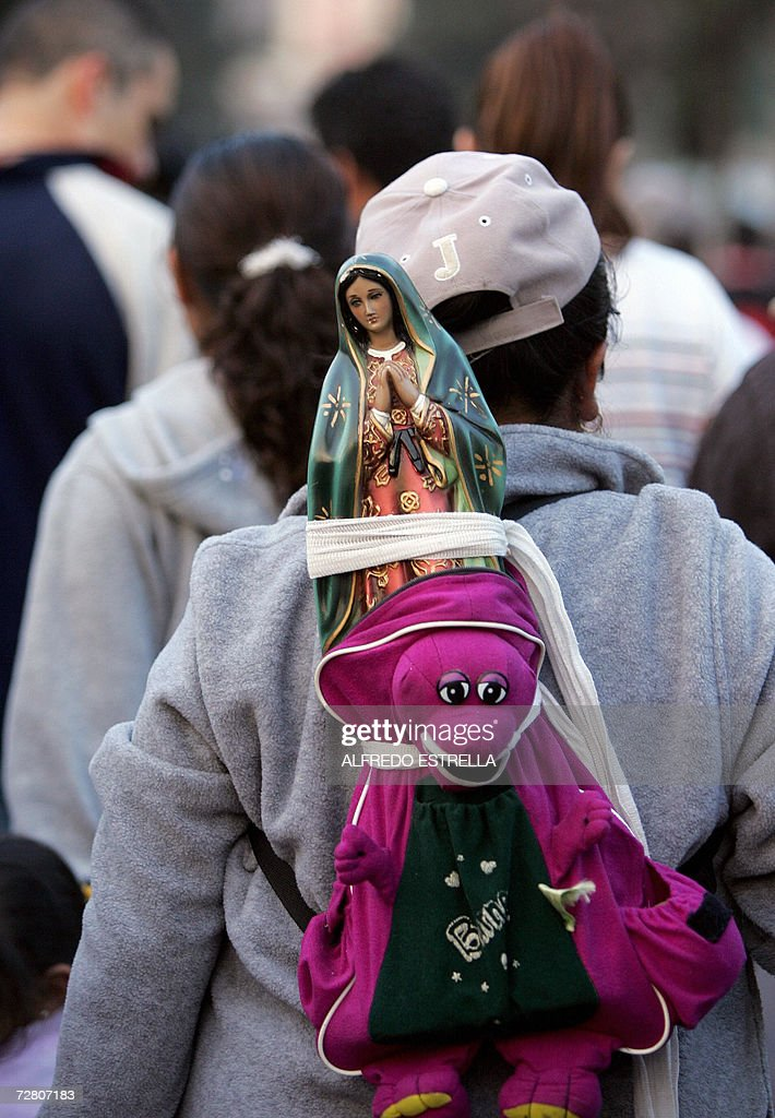 A Mexican pilgrim carries the likeness of the Virgin of Guadalupe outside the Basilica of Guadalupe during celebrations in Mexico City 11 December 2006. AFP PHOTO/Alfredo ESTRELLA
