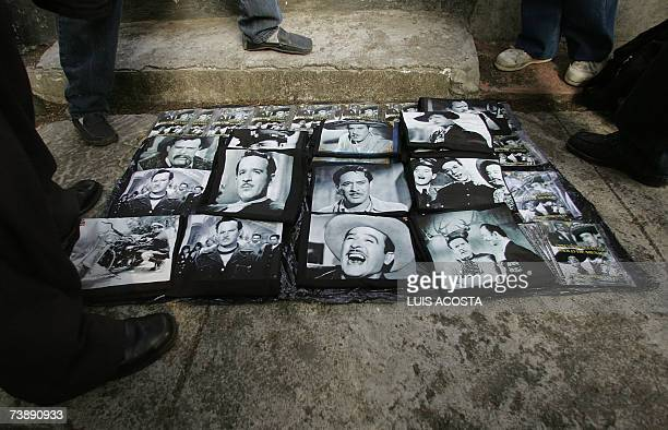 A peddler sales Tshirts with pictures of the late Mexican actor and singer Pedro Infante during the commemoration of the 50th anniversary of his...