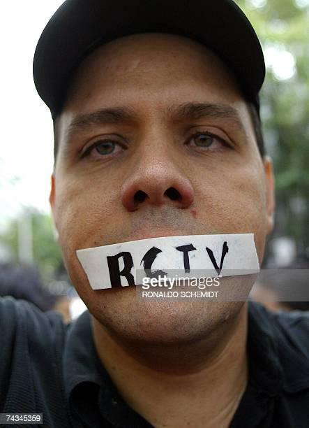 A Venezuelan with his mouth taped protests against the closure of the broadcast station RCTV outside the Venezuelan embassy in Mexico City on May...
