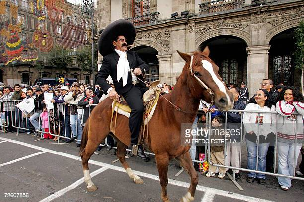 An actor impersonating revolutionary leader Emiliano Zapata takes part in the parade commemorating the 96th anniversary of the Mexican Revolution 20...