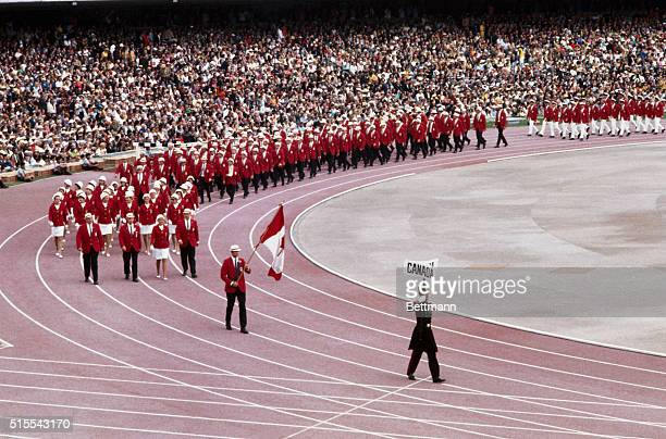 Canada and Ceylon are among the teams marching into Olympic Stadium during opening ceremonies of the 1968 Olympic Games