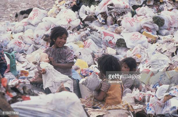 Children of members of the Sindicato de los Pepenedores or Scavenger Union play with dolls at the Santa Catarina Dump outside Mexico City Mexico...