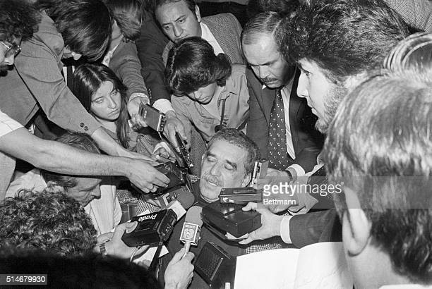3/26/1981 Mexico City Mexico Colombian leftwing novelist Gabriel Garcia Marquez is surrounded by Mexican newsmen with tape recorders and microphones...