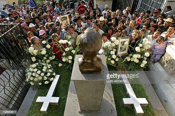 Fans of Mexican actor and singer Pedro Infante sing in front of his tomb during the commemoration of the 50th anniversary of his death at the...