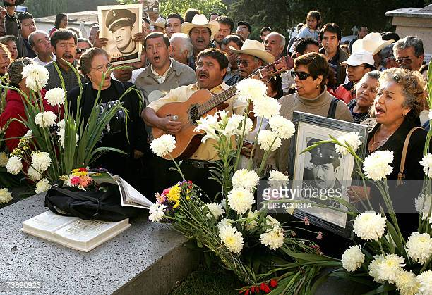 Fans of the late Mexican actor and singer Pedro Infante sing in front of his tomb during the commemoration of the 50th anniversary of his death at...