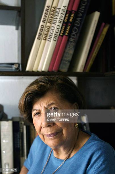 Guadalupe Marin Rivera daughter of the famous muralist Diego Rivera poses in front of her library during an interview with AFP 14 September 2006 in...