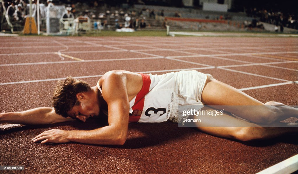 Kurt Bendlin of West Germany is near exhaustion at the finish of the 4400 meter run in the 1968 Olympics Decathlon.