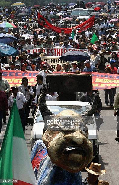 Members of different unions march in Mexico City, 16 June 2006, in support of Oaxaca' schoolteachers, who on Wednesday clashed with the police. Some...