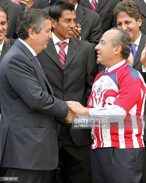 Mexican President Felipe Calderon shakes hands with Jorge Vergara Chivas de Guadalajara Mexican football team owner at Los Pinos presidential...