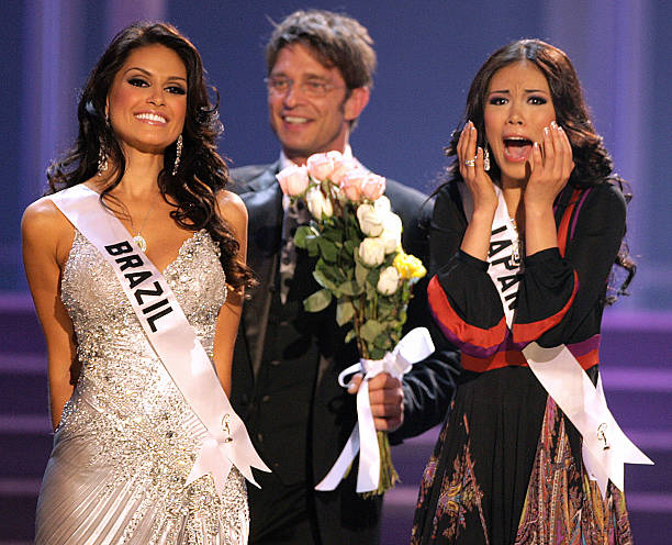 Miss Japan Riyo Mori reacts as Miss Brazil Natalia Guimaraes looks on during the finals of the Miss Universe 2007 pageant in Mexico City 28 May 2007...