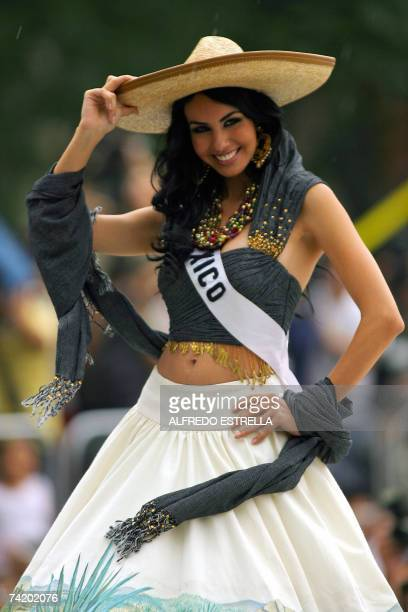 Miss Mexico 2007 Rosa Maria Ojeda poses for photographers during the runway with traditional dresses at the Reforma Avenue in Mexico City 20 May 2007...