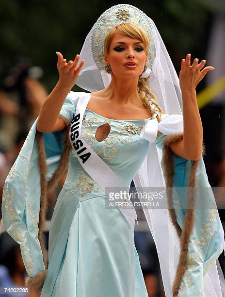 Miss Russia 2007 Tatiana Kotova poses for photographers during the runway with traditional dresses at the Reforma Avenue in Mexico City 20 May 2007...