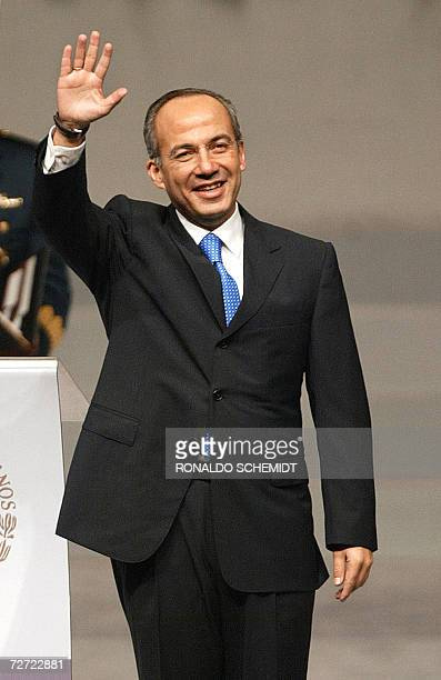 Newly inaugurated Mexican President Felipe Calderon waves to the audience 01 December 2006 at the National Auditorium in Mexico City Calderon...