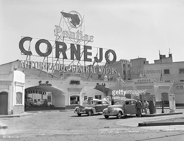 Photo shows a gas station in Mexico City Mexico There appears to be a Pontiac parts supplier or mechanic in the building complex Undated