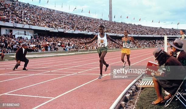 Naftali Temu of Kenya winning the 10000 meter run for the Gold medal in the 1968 Olympics In second place is Silver medal winner Mamo Wolde of...