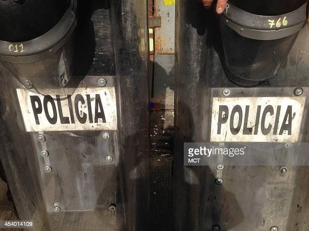 Mexico City police hold riot shields outside the Senate building on Friday Dec 6 as protests erupt over a proposal to open up the nation's energy...