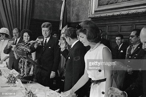 Mexico City: President John F. Kennedy and President Lopez Mateos drink a toast following President Kennedys speech at luncheon in his honor at...
