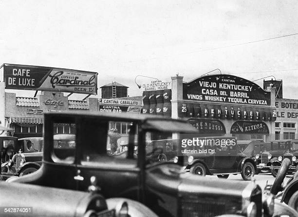 Mexico City views Mexican town close to the US border during the prohibition in the USA 1920-1933: on the main street there is one 'Cantina' after...