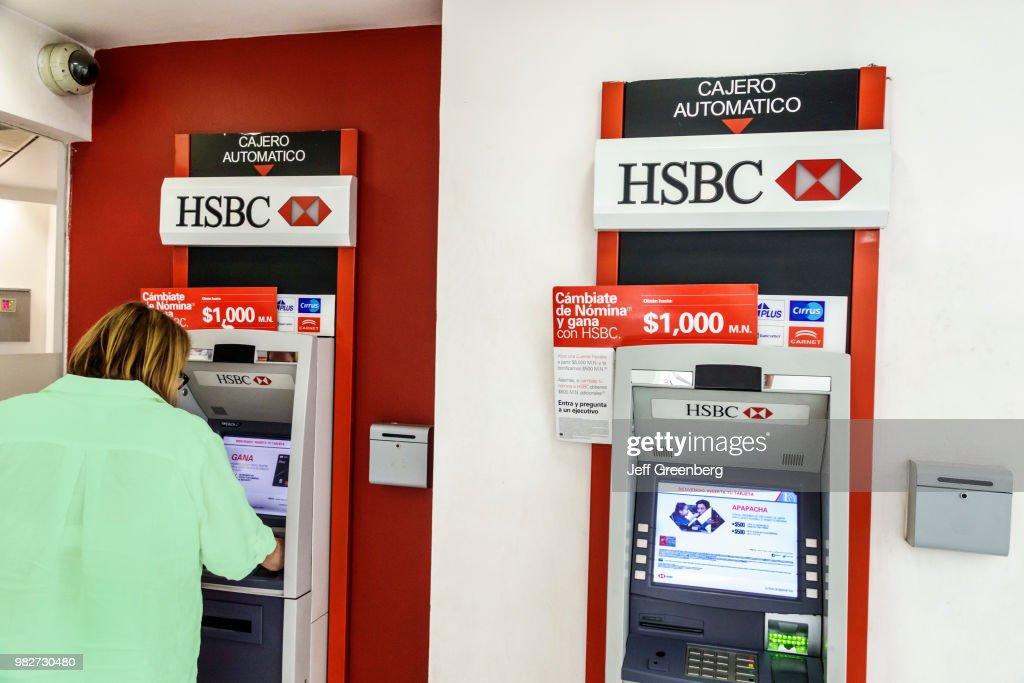 Mexico City, Woman using HSBC Bank, ATM, automatic teller machine