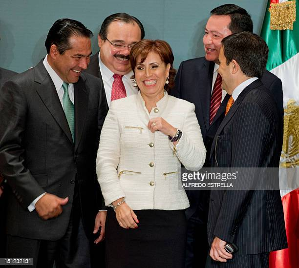 Mexico City's former mayor Rosario Robles is surrounded by Luis Enrique Miranda Nava Carlos Ramirez Marin Miguel Angel Osorio Chong and Ildefonso...